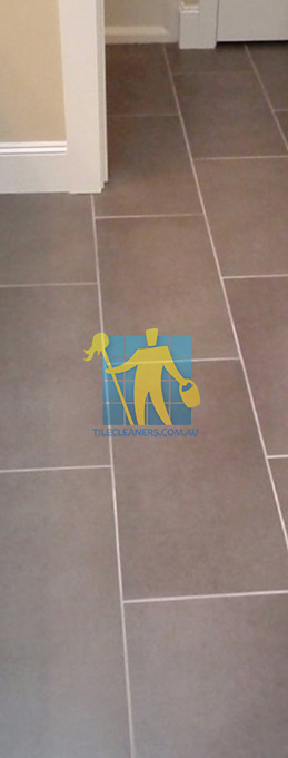 traditional bathroom with brown porcelain tiles rectangular with white grout lines Adelaide