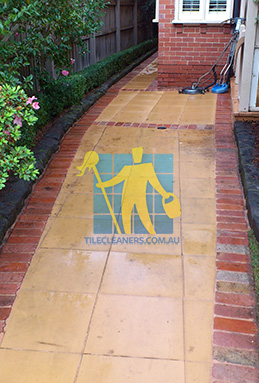outdoor sandstone tiles pavers wet from cleaning with quarry tiles around Adelaide